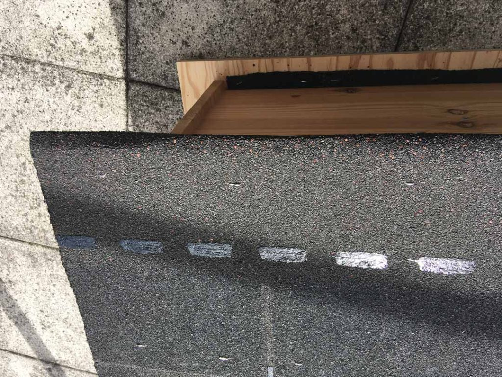 I used a staple gun to affix the shingle to the roof. The nails I had would have been too long. Not also the thin strip of shingle at the base to seal a crack.